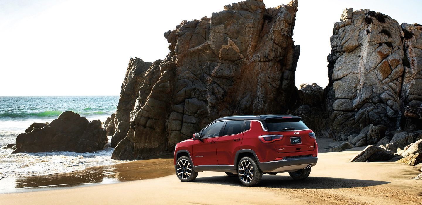 A refined and athletic profile lets the Jeep Compass stand out on sandy shores and city streets.