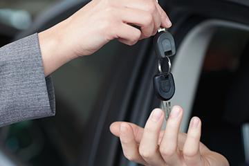 handing off the car keys to a happy customer